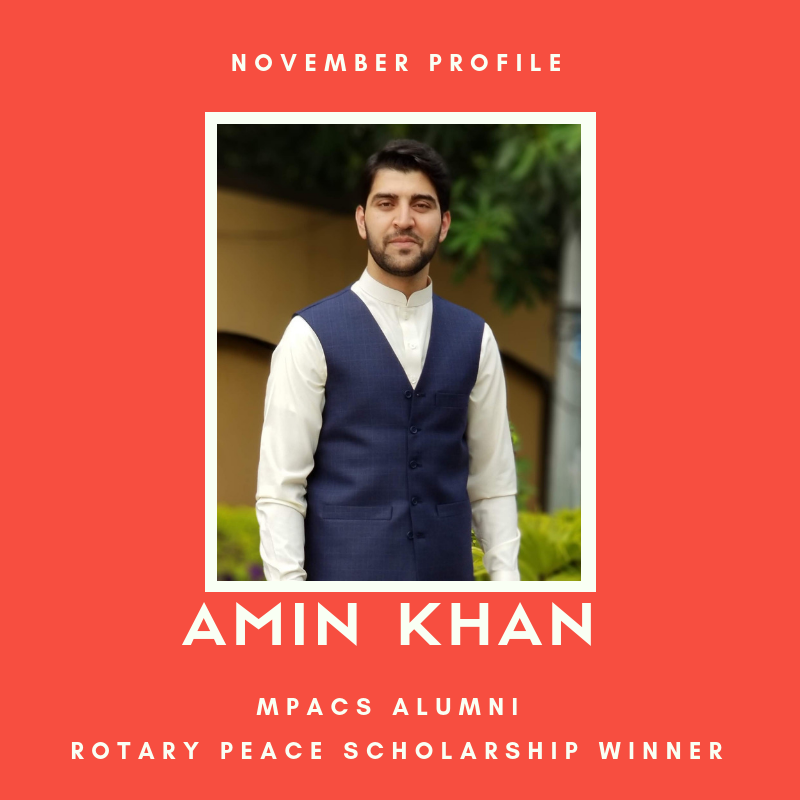 "Picture of Amin Khan against a red background. Text reads: ""November profile. MPACS alumni. Rotary Peace Scholarship winner."""