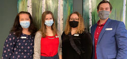 Four staff members of Extend in the pharmacy wearing masks