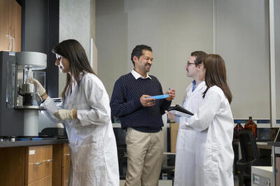Graduate students and Prof Nekkar in the lab