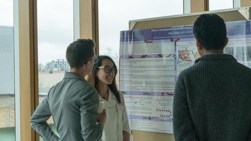 Amy Phan presenting her research to two graduate students
