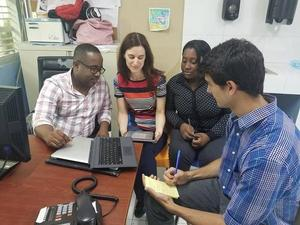 Olivier Millette in discussion with coworkers at the hospital in Haiti