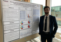 Sam Dusbinsky in front of research poster