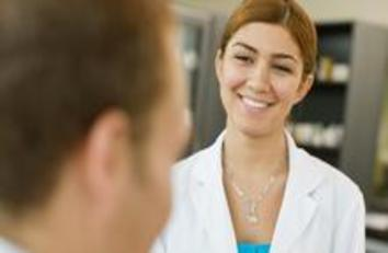 A pharmacist smiling at a patient