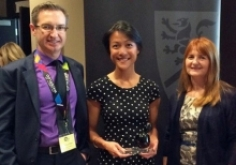 Experiential team members standing with co-op employer award winner