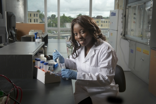 Nyasha holding a pipette in a lab
