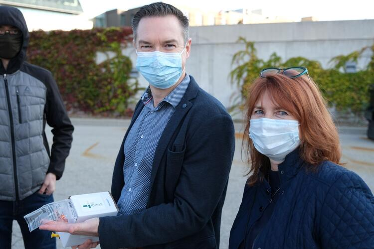 Anthony Miller and Nancy Wait in masks outside the pharmacy building