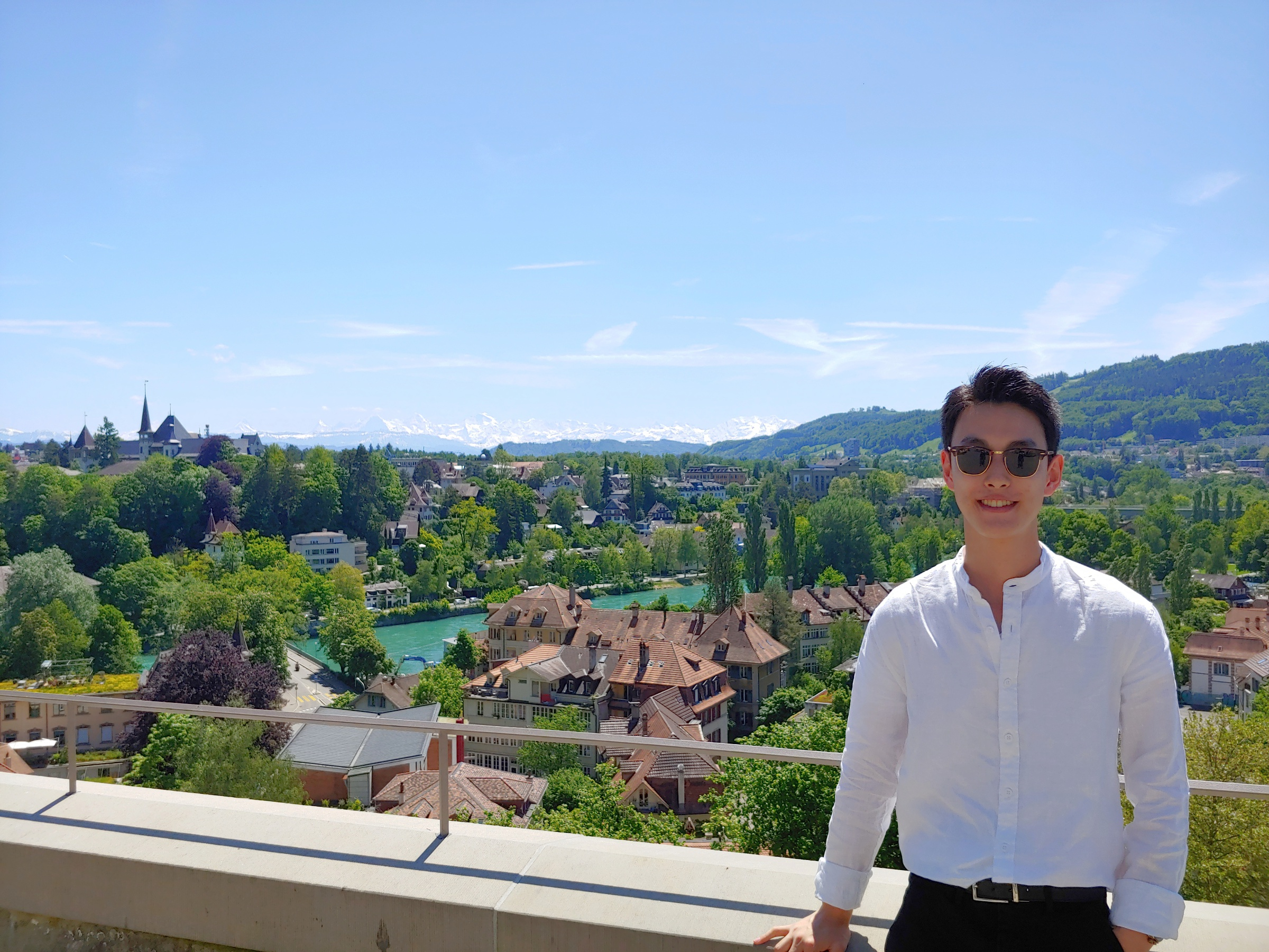 John standing on a balcony overlooking the city of Bern