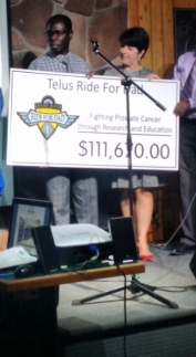 "Grand River staff receive a cheuqe for $111,670 from the Telus Ride for Dad foundation. The cheque reads ""fighting prostate cancer through research and education""."