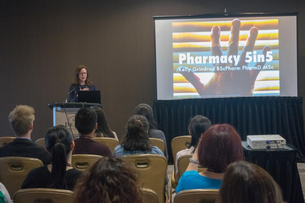 Kelly presenting on Pharmacy5in5 in front of crowd