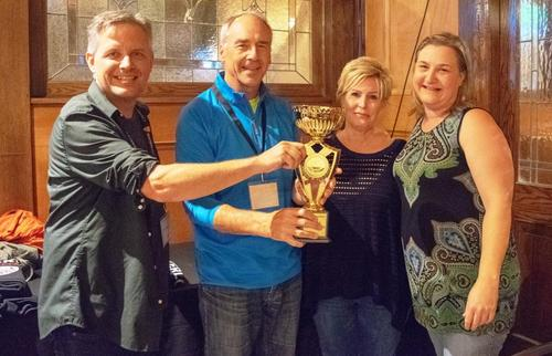 Tom Mcfarlane, Dave Edwards, Trenny McGinnis and Christine Bird with trivia trophy