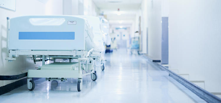 Hospital hallway with bed