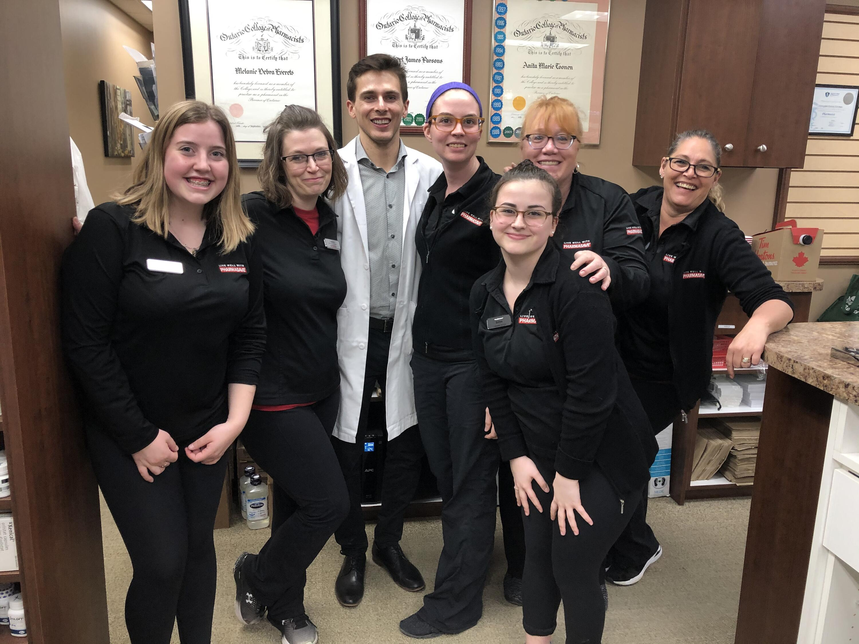Joey (centre) with staff from the Ingersoll Pharmasave