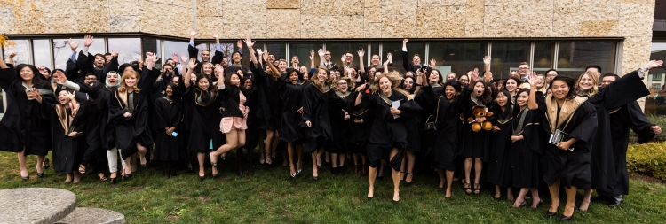 Class of 2016 smiling and wearing graduation gowns