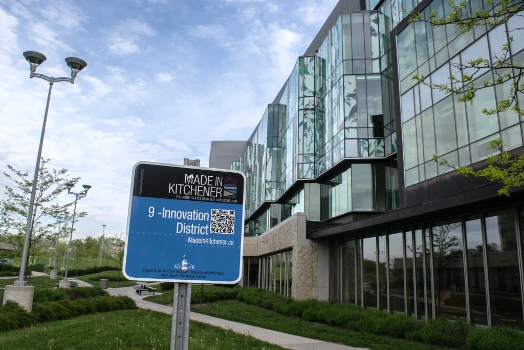 School of Pharmacy behind Made in Kitchener Stop 9 sign for Innovation District