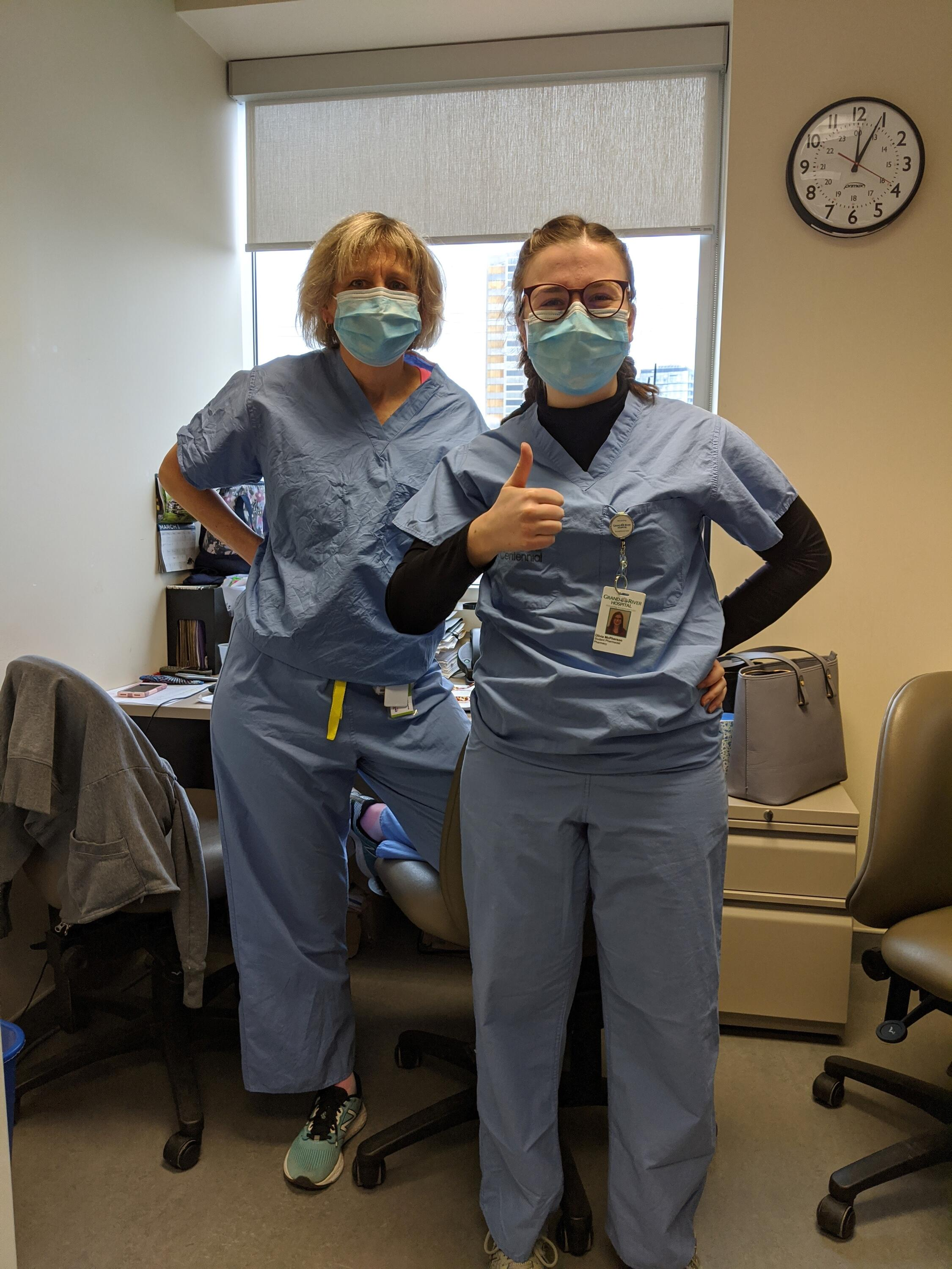 Olivia and supervisor wearing scrubs and face masks