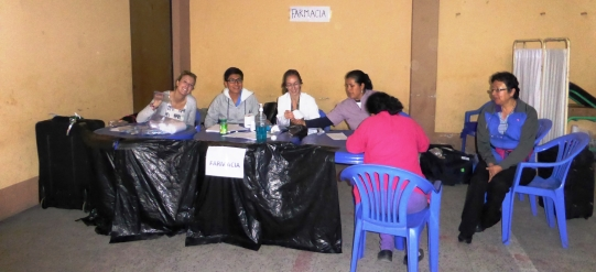 Sandra and fellow volunteers around table at clinic