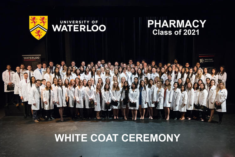 Rx2021s at their white coat ceremony in their new coats on stage