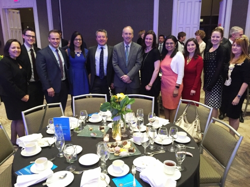 Group of faculty and alumni 12 at the Waterloo Pharmacy table of thei nnovation gala