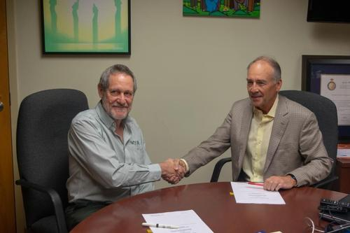 Dr. Roger Strasser, Founding Dean of NOSM, signing a memorandum of understanding with Hallman Director David Edwards.