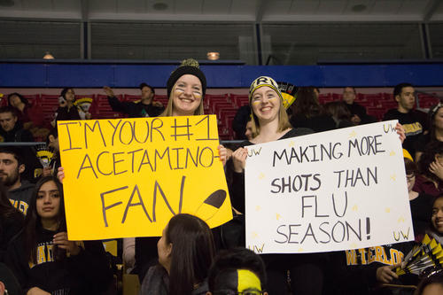Fans with pharmacy themed signs