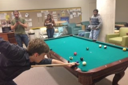grad students playing pool