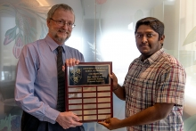 Lokesh accepting award from Dr. Blay.