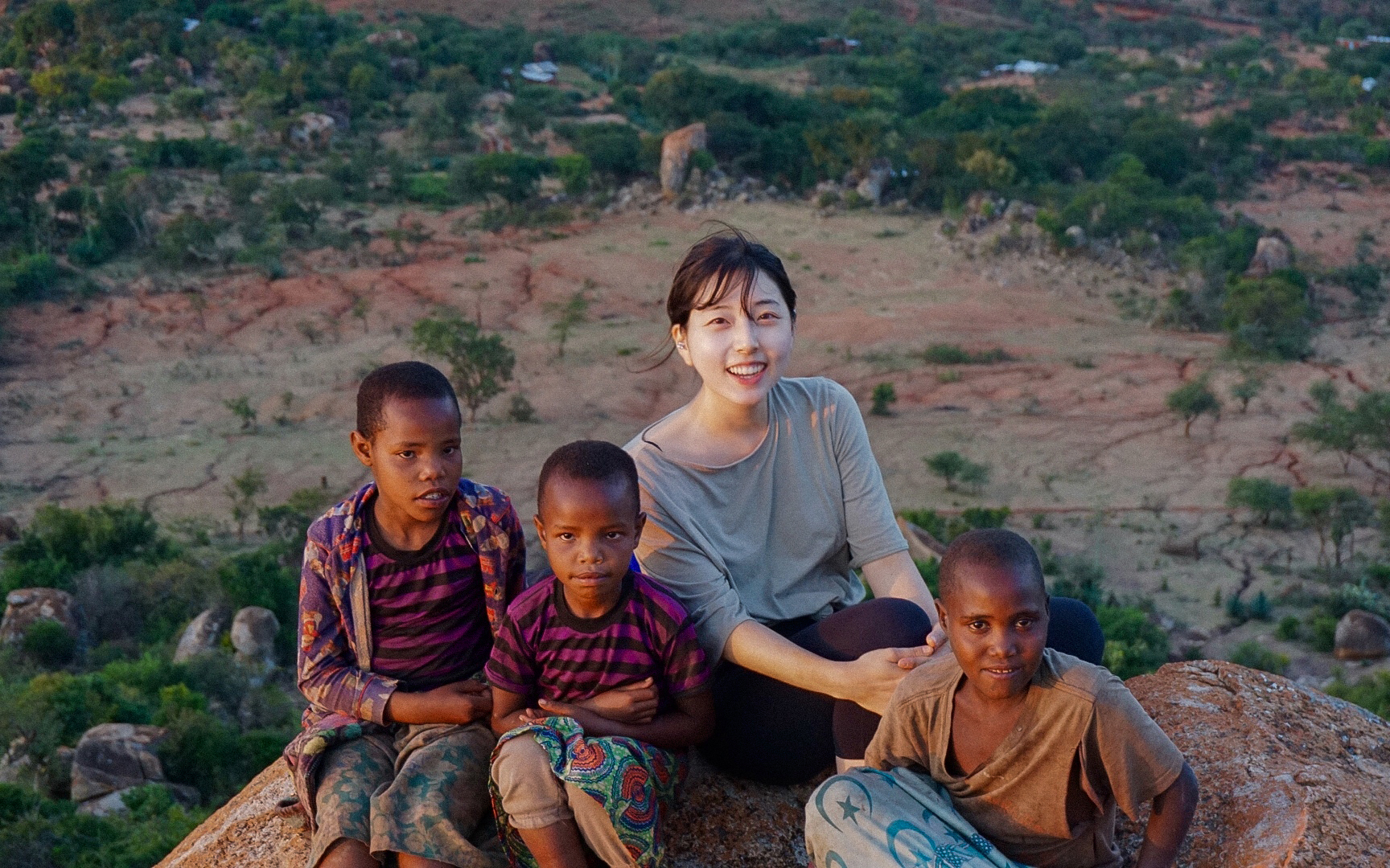 Jung In with Tanzanian children atop Haydom mountain