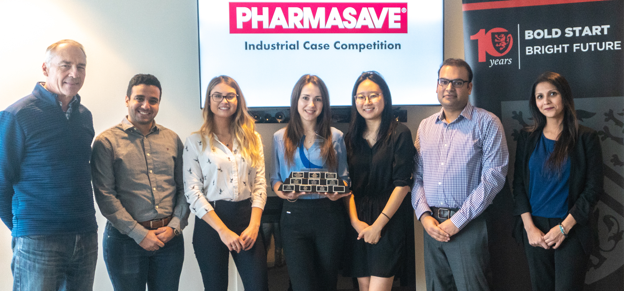 Winners of the Pharmasave Industrial Case Comeptition smiling with trophy, Dave Edwards and Jaspreet Dhaliwall.