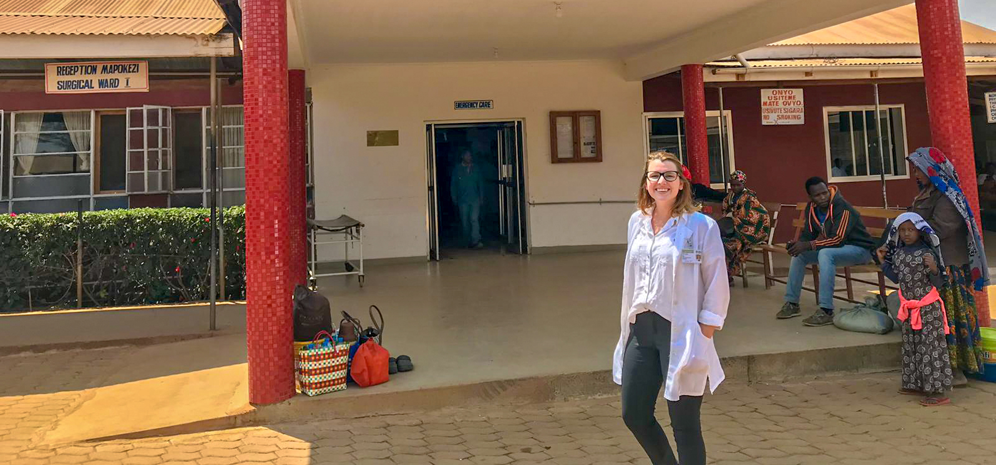 Katie standing outside Haydom Lutheran Hospital in Tanzania