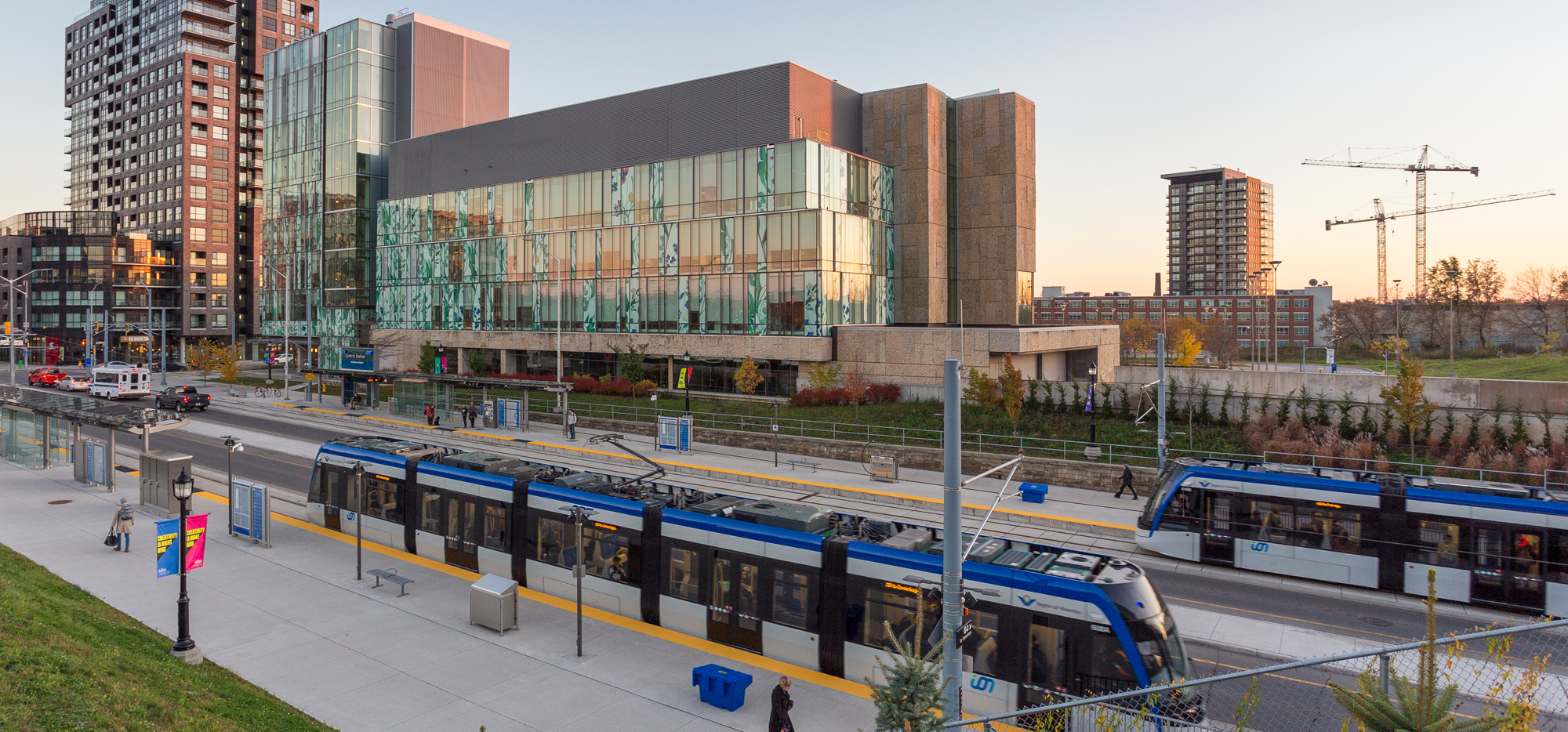 School of Pharmacy building with light rail trains in front of it