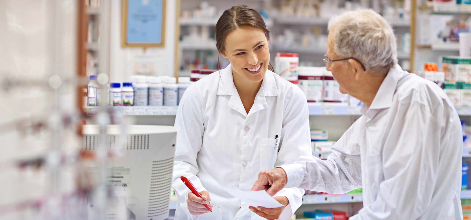 smiling pharmacist talking to patient