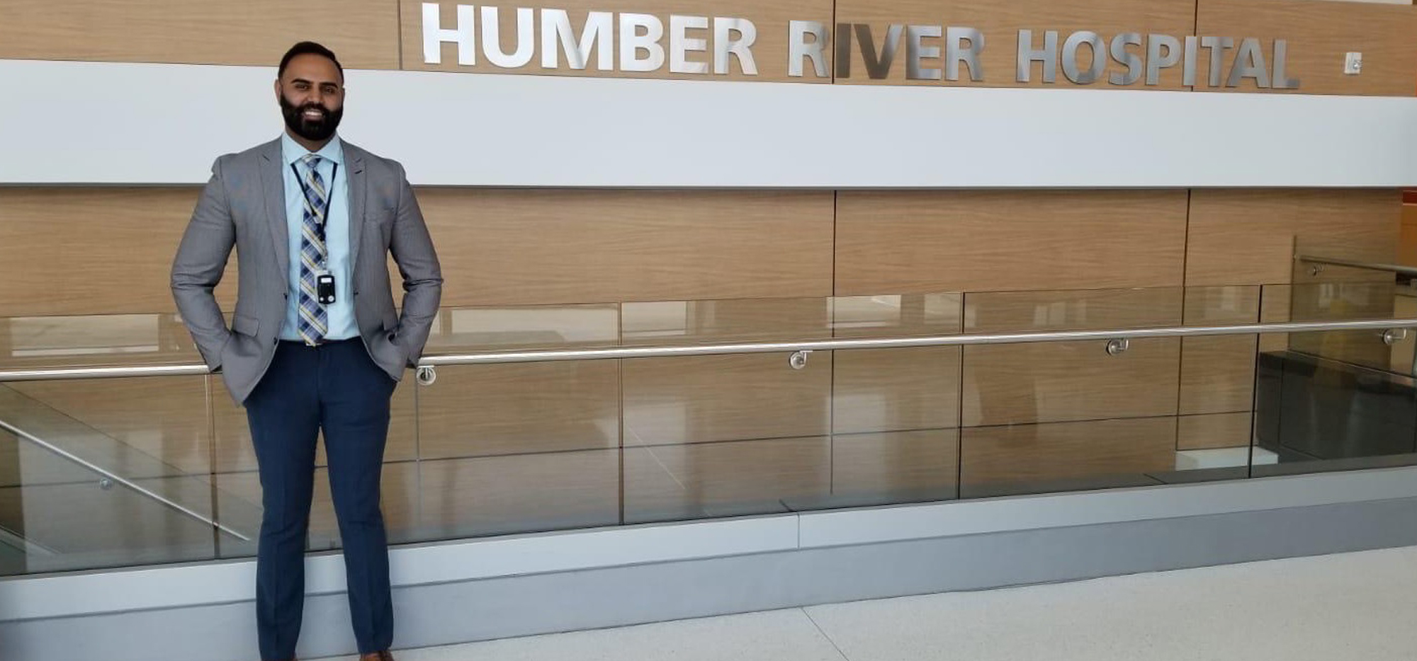 Gaganpal Mutti standing in front of a sign that says Humber River Hospital