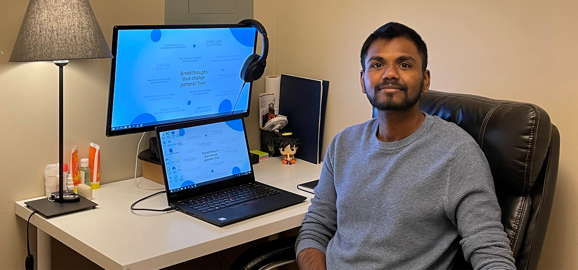 Gokul Pullagura sitting at computer in home office