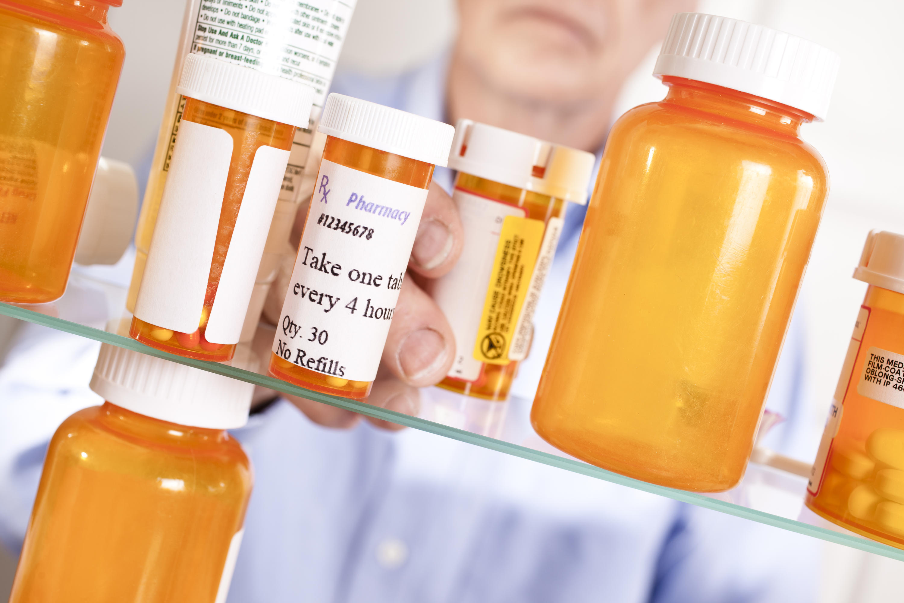 Medication bottles on a shelf