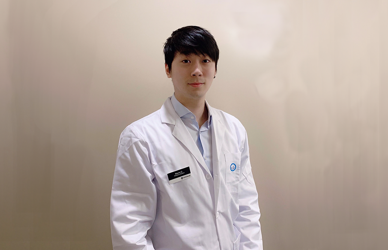 Kevin Choi in a lab coat