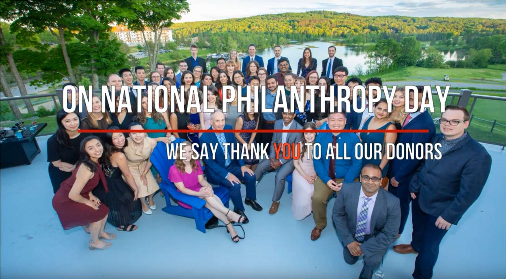 On national philanthropy day we say thank you to all our donors. Group of smiling students at conference.