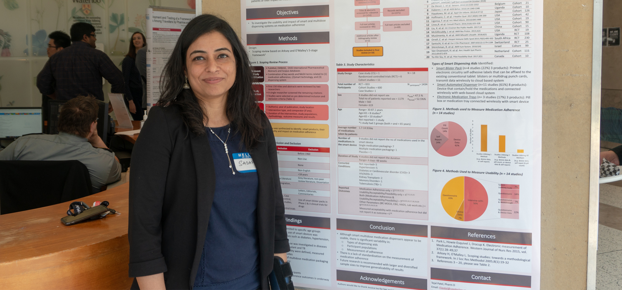 Sadaf in front of a research poster