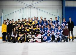 UofT and UW hockey teams on the ice