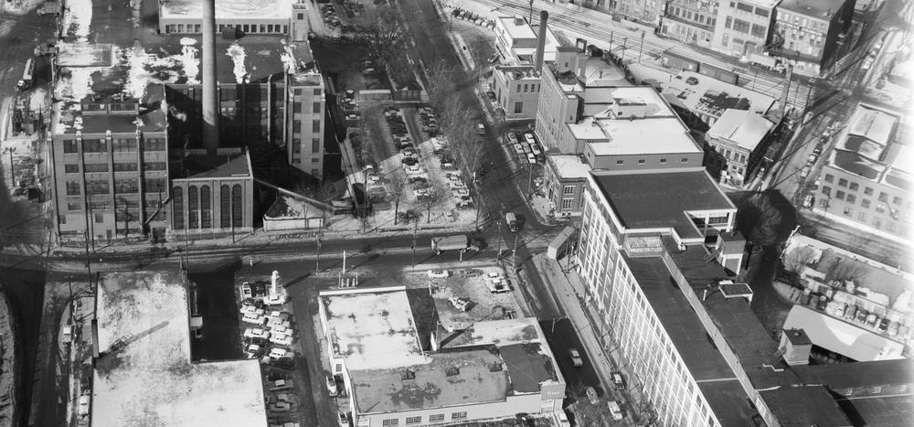 Black and white photo of King and Victoria intersection showing old industrial buildings