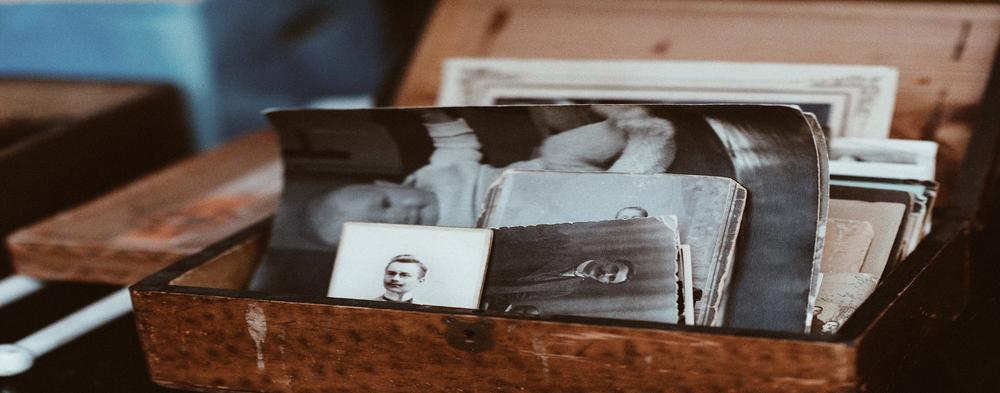 Wooden box filled with old photographs