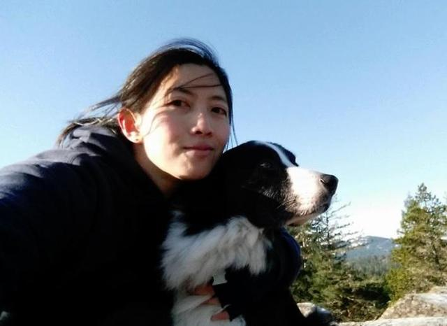 Dr. Audrey Yap holding her dog outside