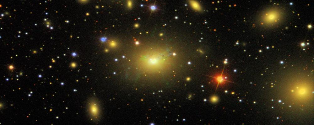 The Perseus galaxy cluster, located about 240 million light-years away, is shown in this composite of visible light (green and r