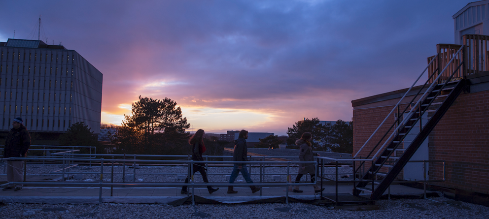 Visitors heading to the upper deck of the Physics Building rooftop