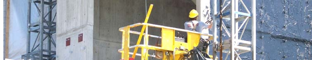 man working in a lift bucket