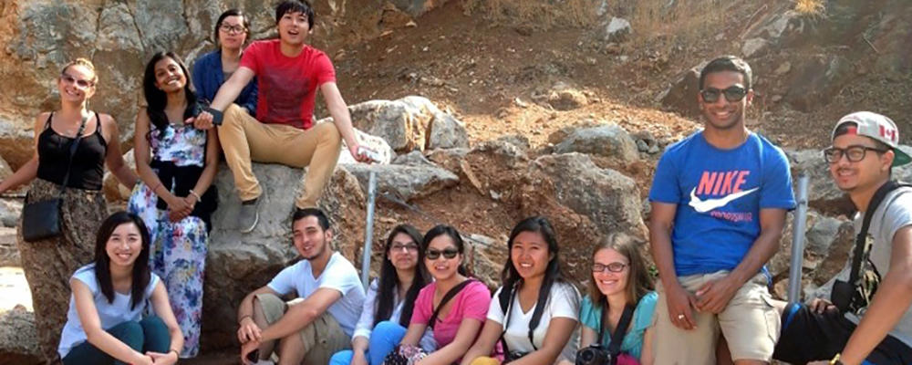 Students in a desert background