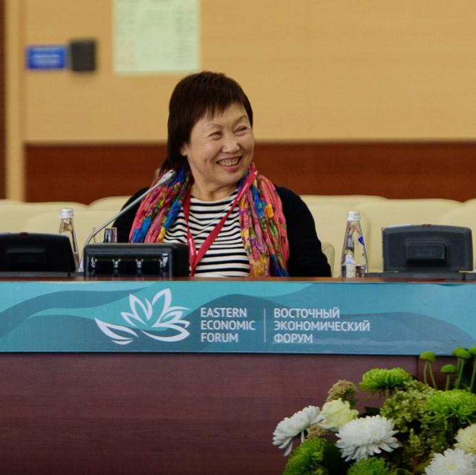 photo of woman at panel