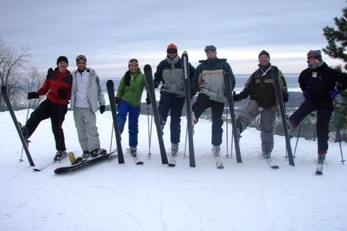 Blue Mountain Ski Resort, March 2008. Seven people standing wearing skis on ski hill.