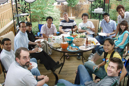 PCL BBQ @ Kaan's house Cambridge, July 2007. People sitting around a table.