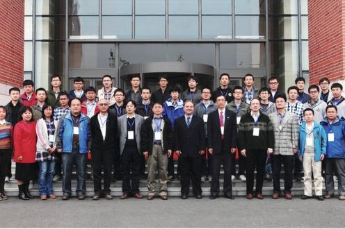 International Workshop on Mathematics and Algorithms for Computer-Aided Manufacturing, MAMENC, Oct 2014. People standing.