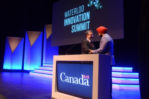 President Feridun Hamdullahpur welcome Honourable Navdeep Bains to the stage.